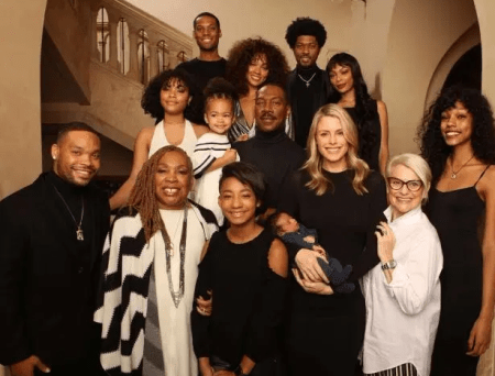 Eddie Murphy poses with all TEN of his kids